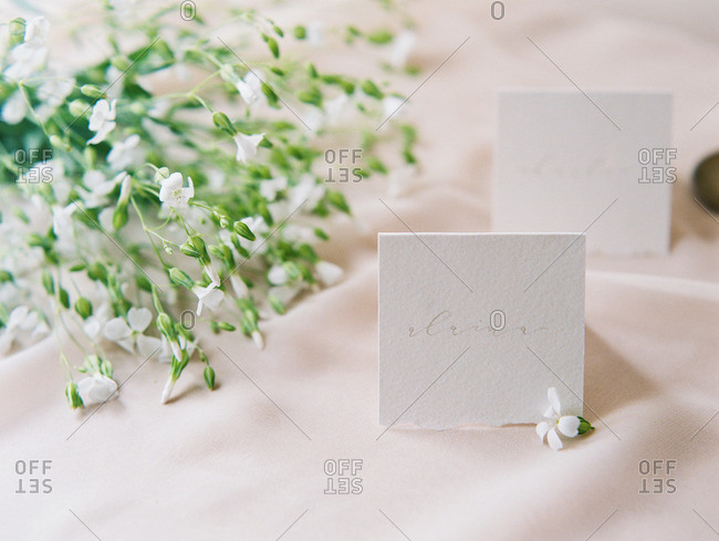 A table set with flowers and a note card