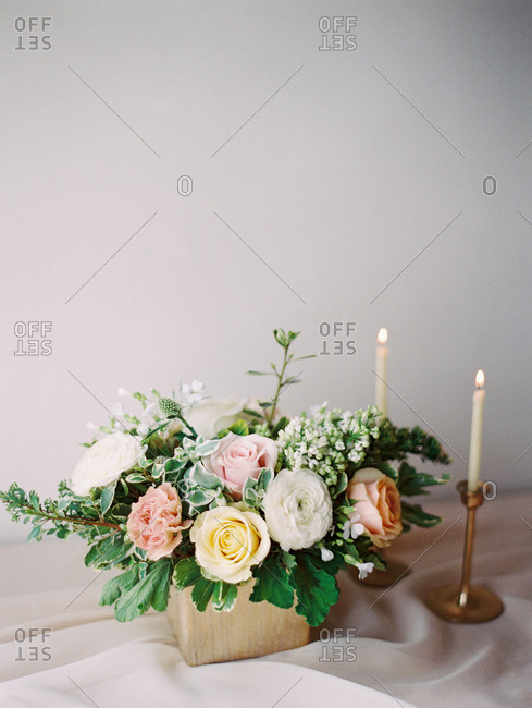 A table set with candles and a bouquet of flowers