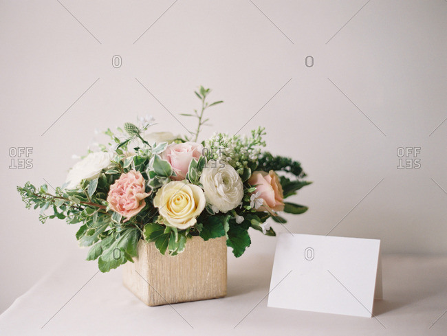 Table set with a card and a bouquet of flowers