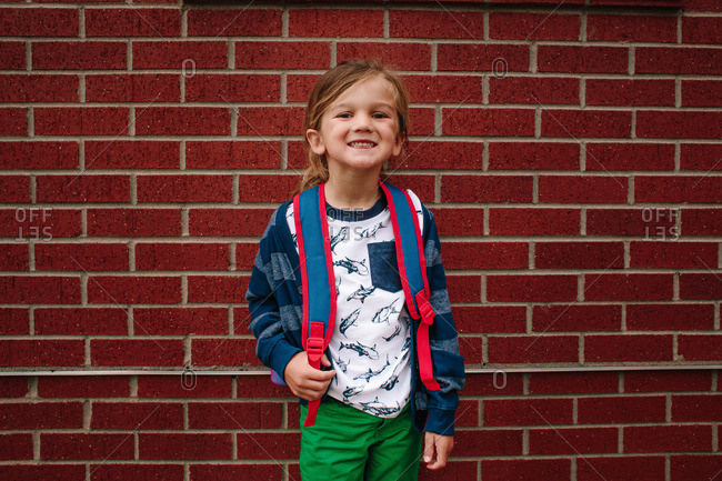 Portrait of a smiling boy wearing a backpack