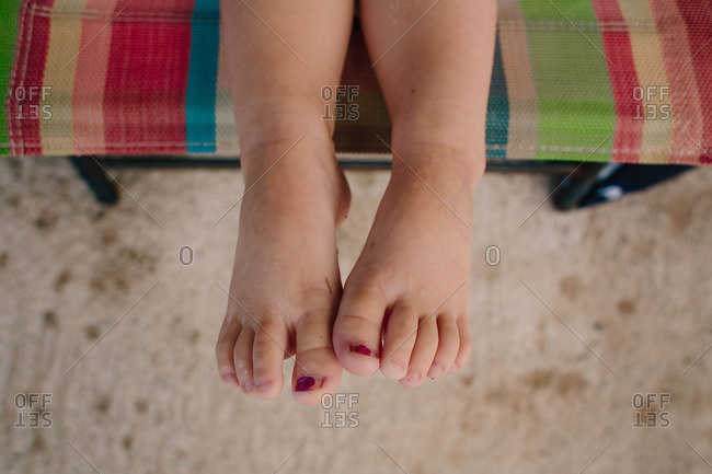 Close up of the bare feet of a child with painted big toes