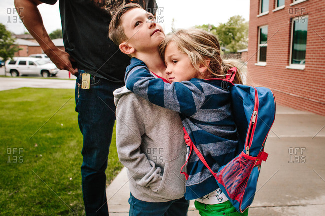 Brothers hugging outside of school
