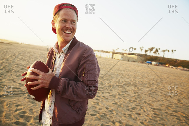 Man playing football on the beach