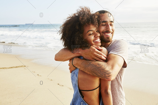 Couple hugging each other on the beach