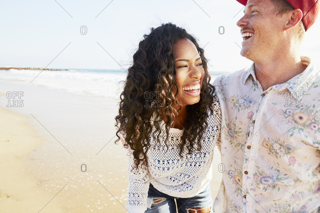 Couple walking together along the beach