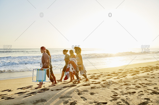 Friends walking together on a beach