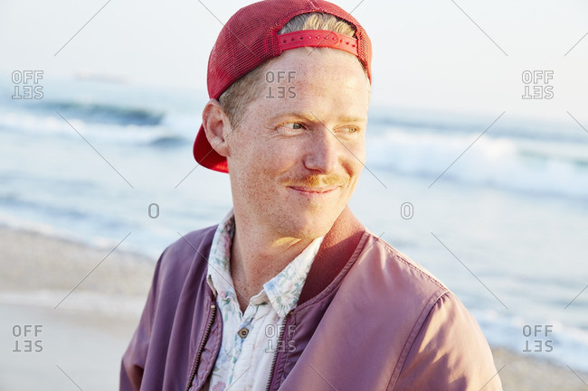 Portrait of a young man standing on a beach