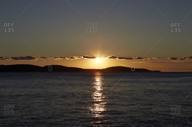 The sun setting over an island