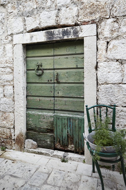 An old green door on a stone building