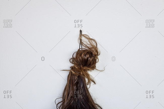 Hair pinned to a wall
