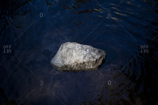Large stone in the water in Kings Canyon, California