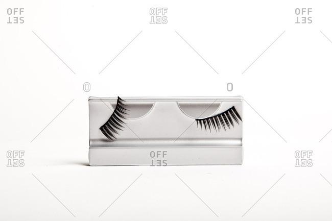 A set of fake eyelashes on a white background