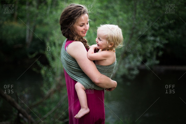 Mother holding her baby in a sling