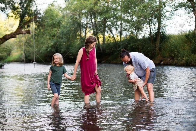 Family playing in a river