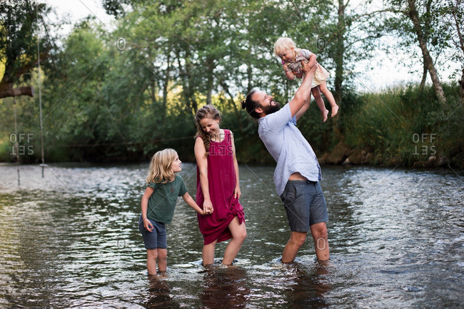 Family standing together in a river