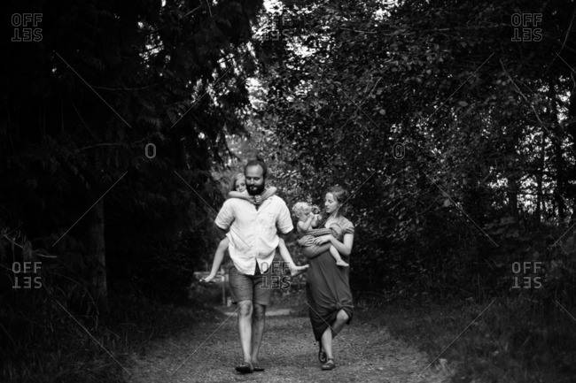 Family walking together on a rural path
