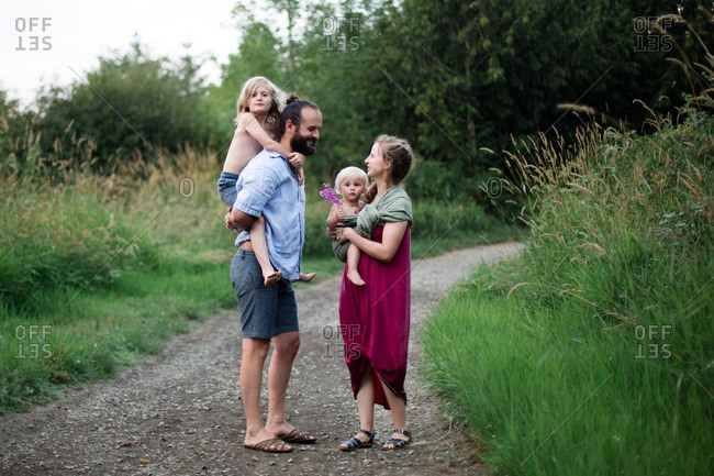 Family standing together on a rural path