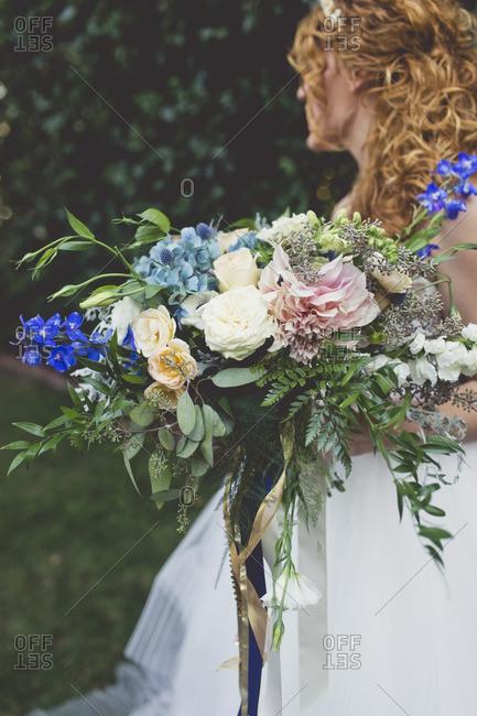 Bride holding large floral bouquet