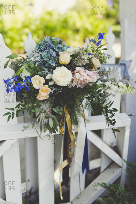Large floral bouquet on a wooden fence