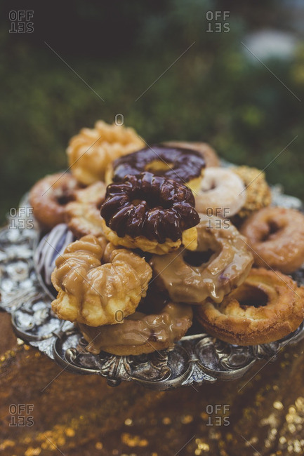 Donuts served on a silver platter at a wedding reception