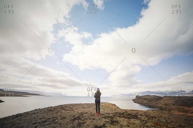 Person looking at the ocean off the coast of Iceland