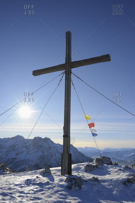 Cross and Buddhist Prayer Flags at Summit, Steinplatte, Waidring, Tyrol, Austria
