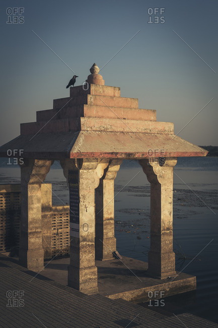 Pigeons Perched on Roof of Hindu Burning Ghat, Somnath Temple, Triveni Mahasangam, Veraval, Gujarat, India