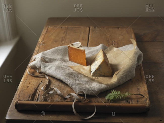 Still Life of Aged Cheeses on Wooden Board