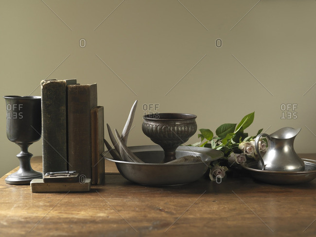 Still Life of Old Books with Silver Goblets, Bowls, Jug and Roses