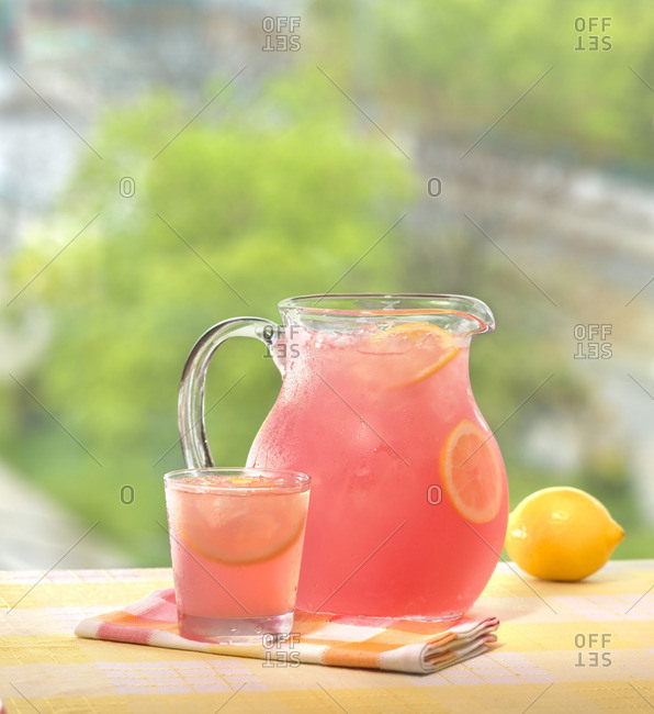 Frosty Pitcher and Glass of Pink Lemonade