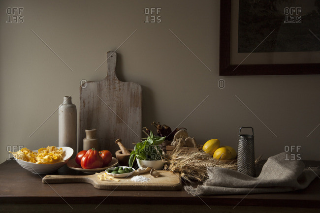 Rustic italian ingredients on wooden tabletop