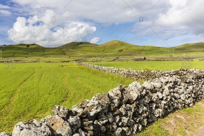 Lava Stone Wall framing Agricultural Fields, Serra da Ribeirinha, Terceira Island, Azores, Portugal
