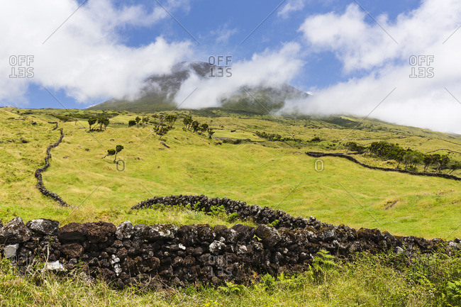 Lava Stone Wall in front of Pastureland and Mount Pico, Pico Island, Azores Portugal