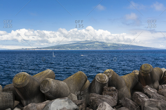 Concrete Wave Breakers with Sailing Boats and Pico Island in the distance, Horta, Faial Island, Azores, Portugal