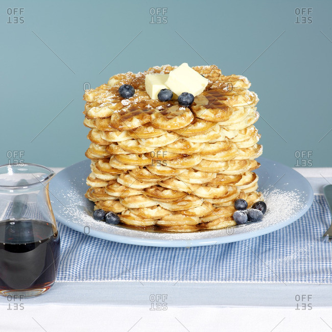 Blue Plate with Butter and Blueberries and Maple Syrup in Jug on the Side