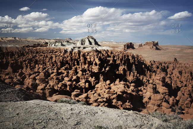 Scenic view of rock formation against sky on sunny day