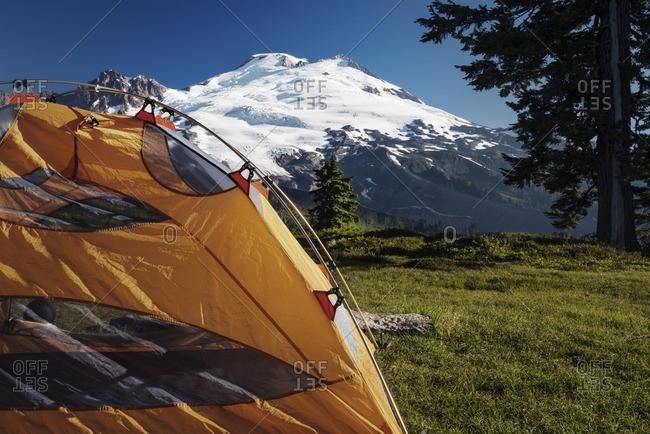 Orange tent on field against sky