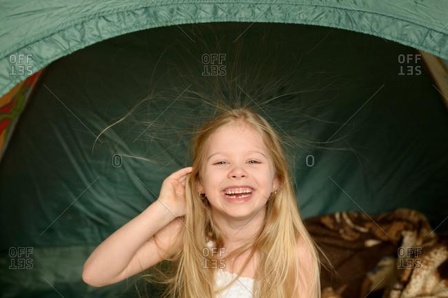 Portrait of happy girl in tent
