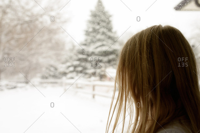 Side view of girl looking at snowcapped