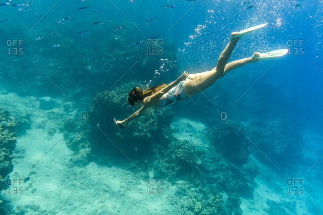 Woman photographing in sea