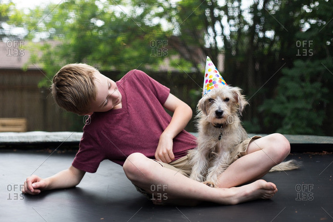 Boy and dog with party hat