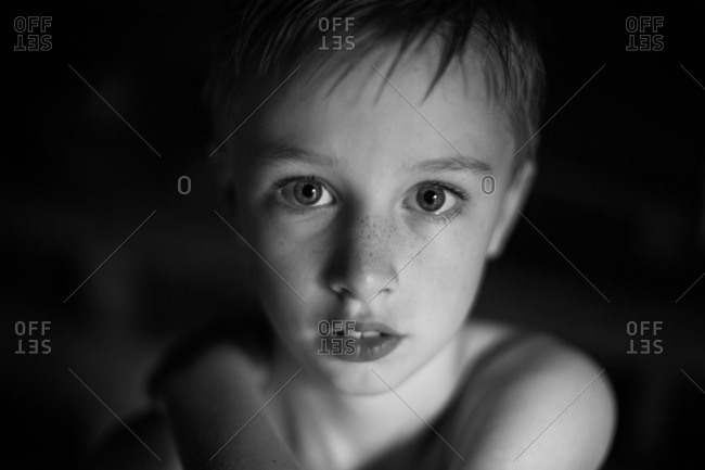 Shirtless boy with freckles