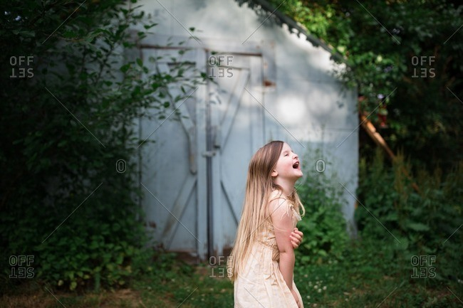 Girl laughing in summer yard
