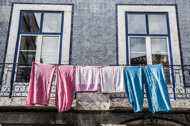 Typical ornate Lisbon house with clothes drying on rope in Lisbon, Portugal