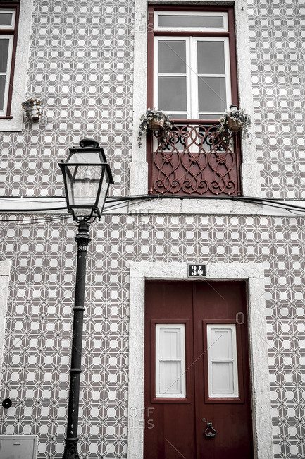 Lisbon, Portugal - April 16, 2014: House with decorative tiled facade and street lamp in Lisbon, Portugal