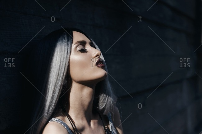 Close-up of beautiful young woman with long silver hair