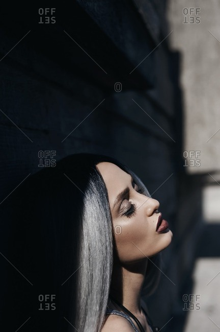 Portrait of beautiful woman with silver hair with her eyes closed