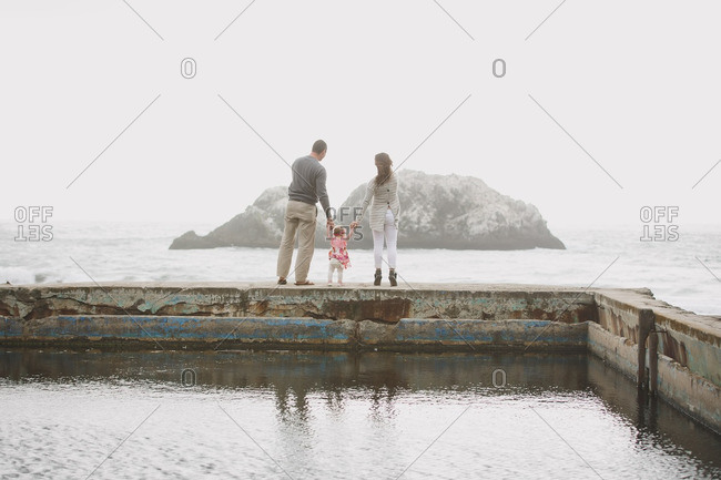 Parents with baby girl at Sutro Baths, Golden Gate National Recreation Area