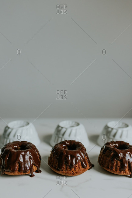 Close up of chocolate filled dessert by white cups