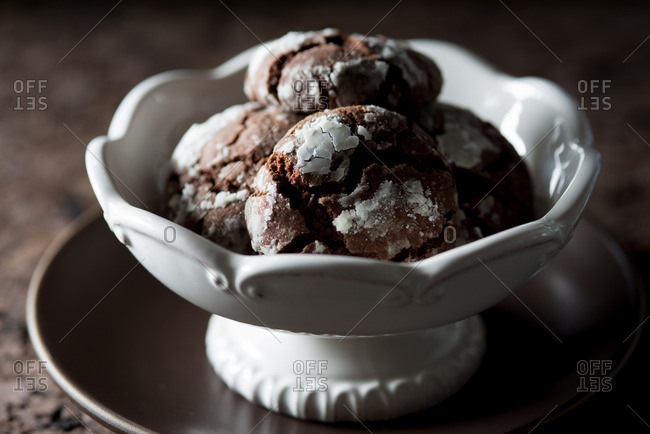 Chocolate crackle cookies in white ceramic bowl